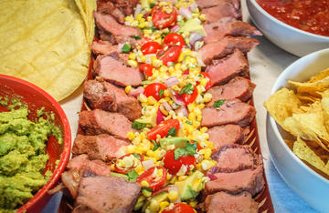 Grilled sweet corn salsa and spicy rubbed backstrap are the perfect summertime combination.