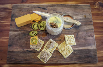 Serve venison potted meat with saltine crackers, cheese, and peppers or pickles for the perfect deer or turkey camp snack.