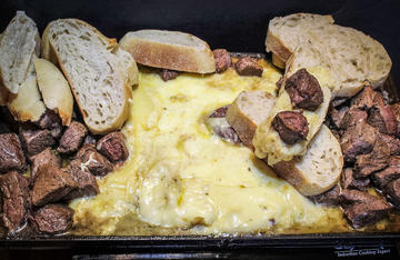 Melted, gooey Swiss cheese paired with tender, butter braised backstrap and crusty bread.