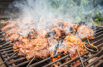 The suya doesn't take long on a hot grill. Sear it for 3 to 4 minutes per side to keep the meat from drying out.