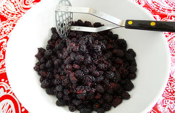 No cooking required, just smash the berries, add the sugar and the Sure Jell, then mix it all up and put it in the freezer.