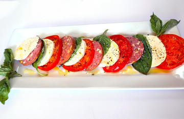Fresh basil and tomato from the garden, fresh mozzarella, venison summer sausage and olive oil is all it takes to make this easy appetizer.