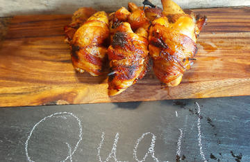 Bacon wrapped quail with an orange maple glaze works well for a main course or as an appetizer.