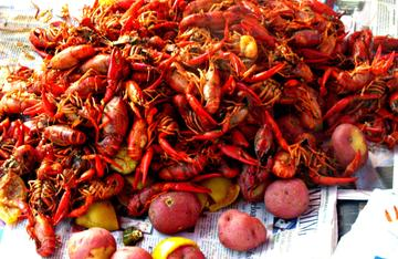 Pour out the crawfish and other ingredients over a paper lined table and get all caveman on the pile.