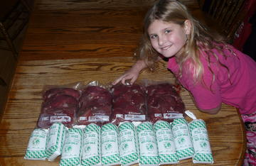Michaela showing off some of the packaged meat from her first buck a few years ago. You work hard to put up a premium product, don't ignore it once it goes into the freezer.
