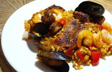 Rabbit, sausage and seafood paella is a great dish when you need to feed a crowd.
