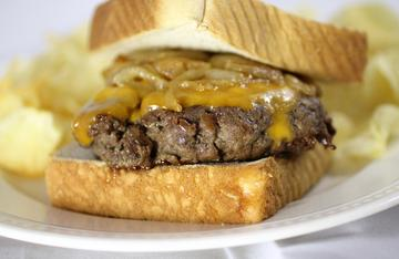 Sharp cheddar and caramelized onions make the perfect toppings for the patty melt.