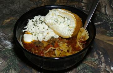 Serve the lasagna soup with a chunk of bread and a dollop of the ricotta cheese topping.