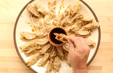Serve the dumplings with a bowl of soy or teriyaki sauce for dipping.