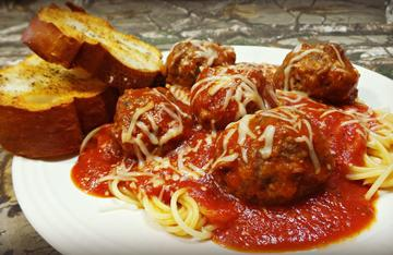 Venison meatballs simmered in marinara sauce over spaghetti.