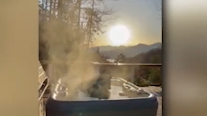 Watch: Bear Relaxes in a Tennessee Cabin Hot Tub With Sunrise View Preview Image