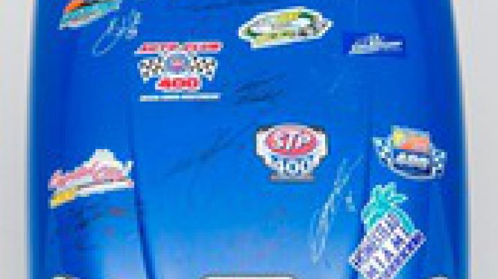 "Bid Now for ""Champ"" The New Holland Tractor Hood Autographed by Winners of NASCAR 2012 Sprint Cup Series Races Preview Image"