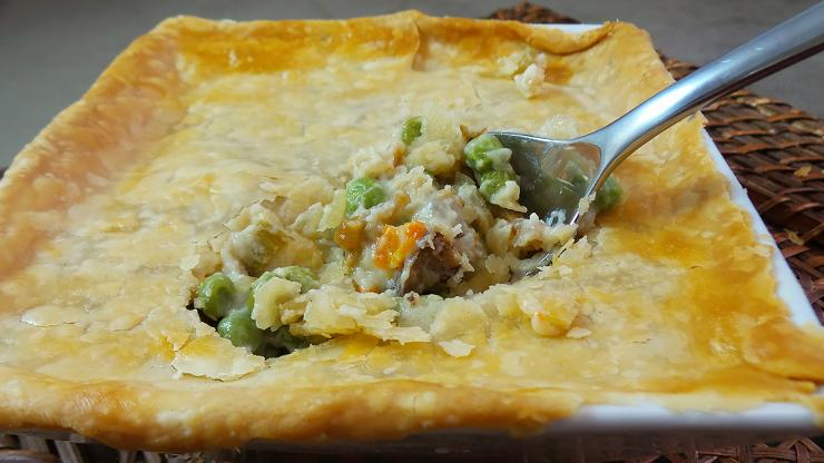 Top the pie with a flaky crust and bake till golden brown.