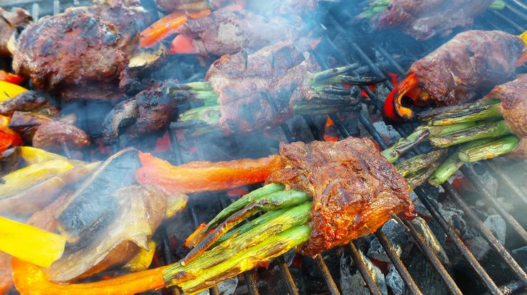 Roll the marinated venison around the vegetables, secure with a toothpick, and grill.