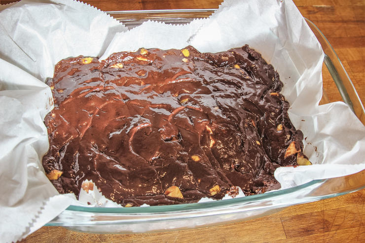Mix bourbon and chopped chestnuts into the melted chocolate and pour into a parchment lined dish.