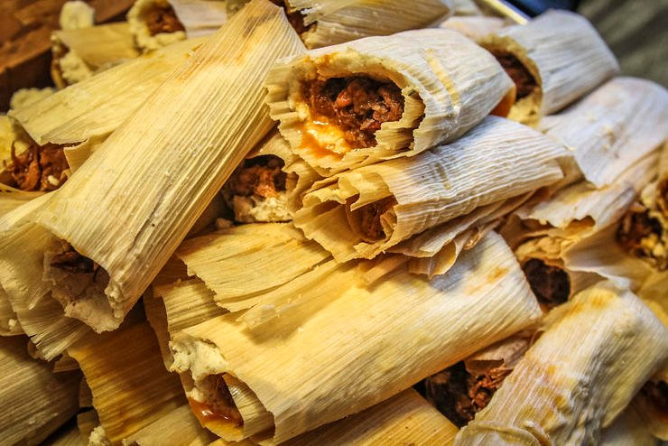 Continue rolling the tamales until all the meat has been used.