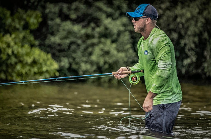 The Banded Realtree Fishing Trucker Hat and Performance Adventure Shirt