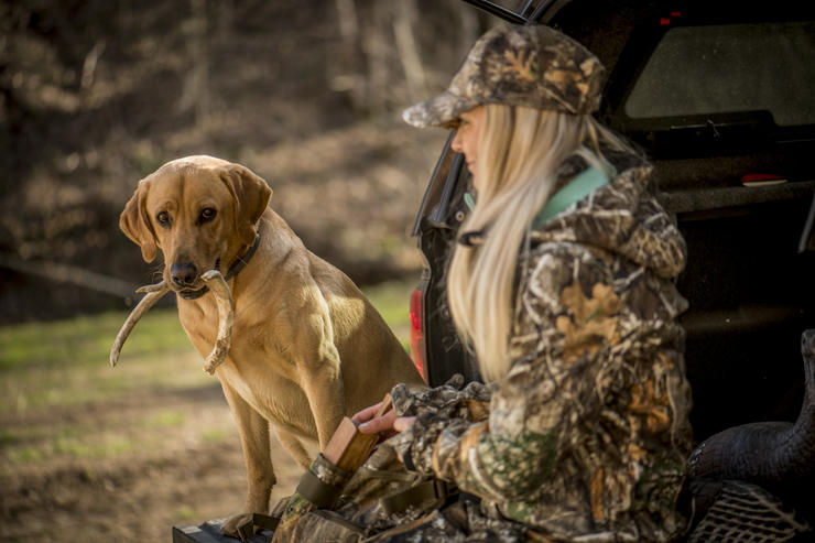 Well-behaved dogs can help you break the ice with land permission. © Bill Konway photo