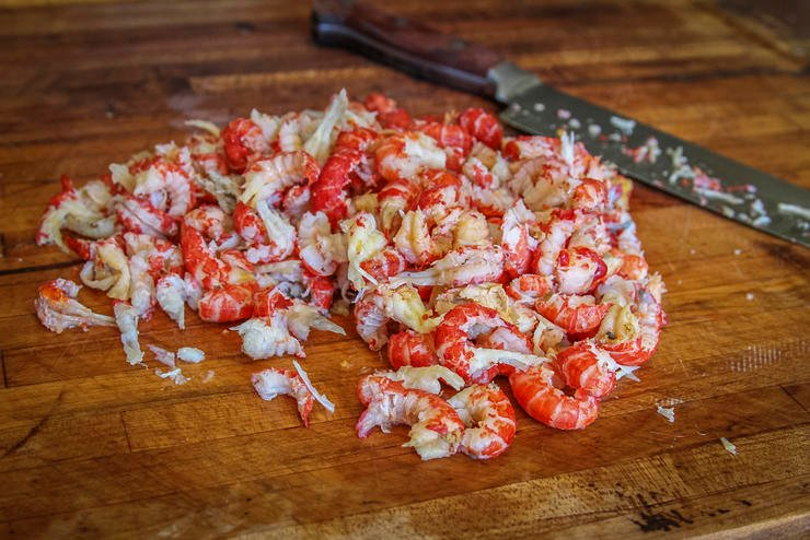 Peel the crawfish tails and give the meat a light chop before mixing the burgers.