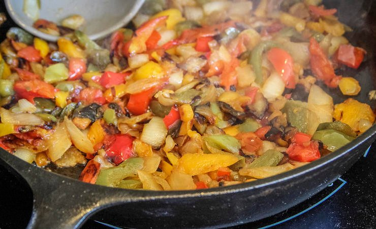 Saute the peppers and onions until completely soft and cooked through.