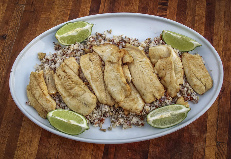 We serve the grilled crappie over a bed of rice and with extra lime for squeezing.