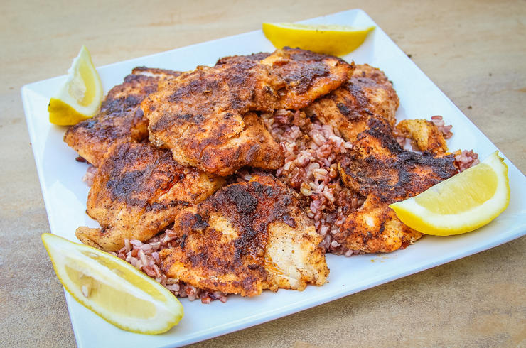Serve the blackened catfish over rice and with lemon wedges to squeeze.