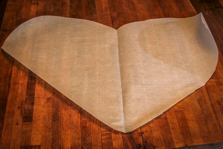 Channel your inner pre-schooler to cut the parchment paper into giant hearts to make folding easy.