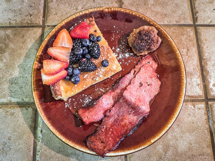 Slice the pancakes into wedges and serve with sides like venison bacon or sausage.