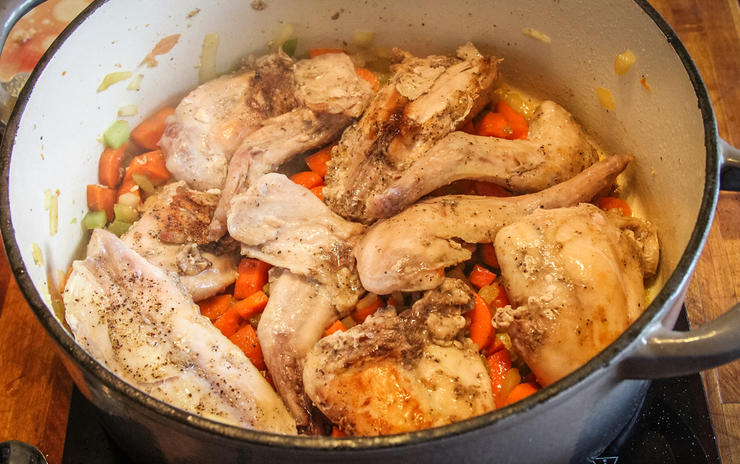 Brown then simmer the vegetables and rabbit before picking the meat from the bone.
