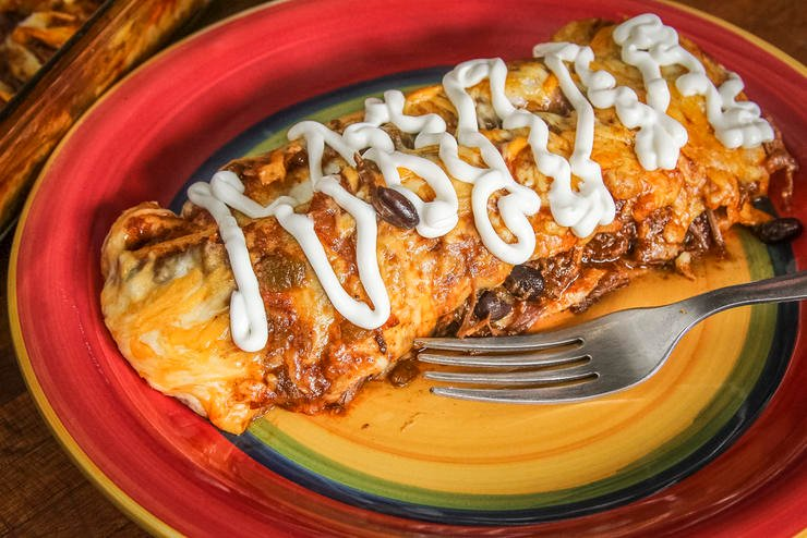 Top the enchiladas with sour cream before serving, if desired.