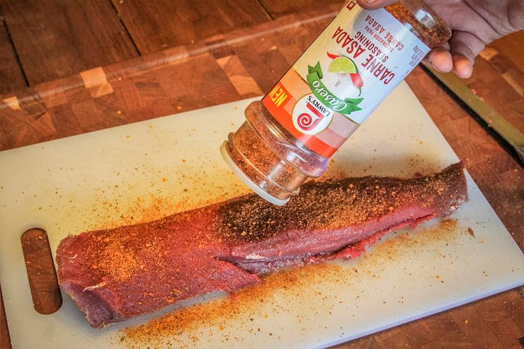 Season the backstrap with your favorite carne asada seasoning blend.