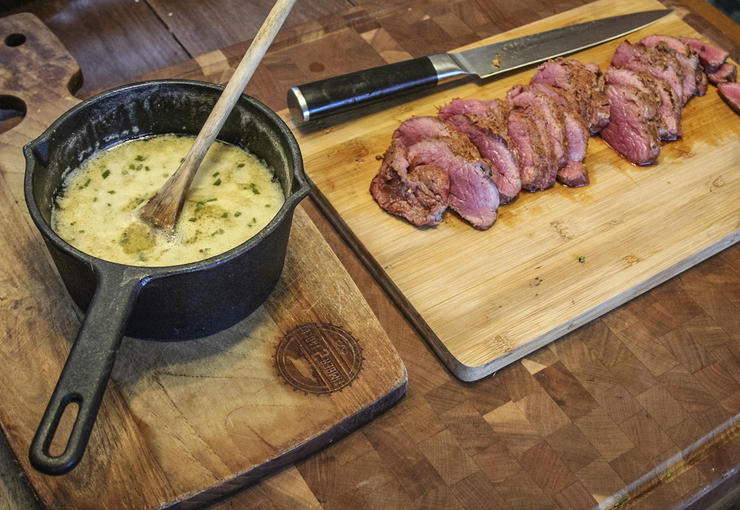 Serve the sauce from the pan and the backstrap from the cutting board, or plate it up and pour the butter sauce into a bowl.