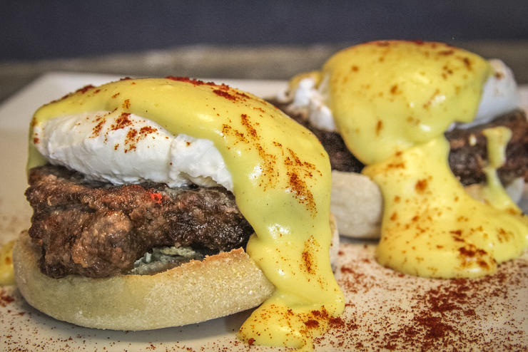 Top the poached egg and backstrap with hollandaise sauce and a sprinkle of smoked paprika.