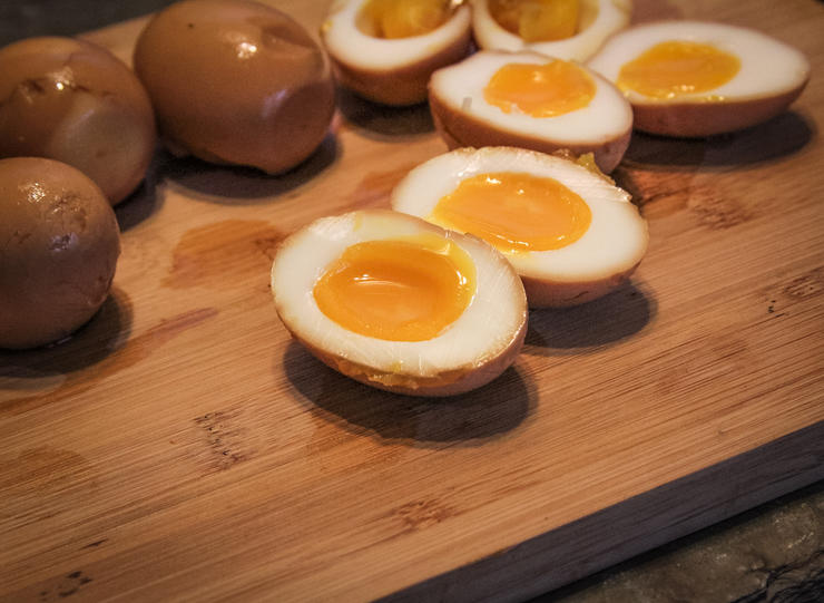 The marinated eggs should have a soft, slightly runny, yolk.