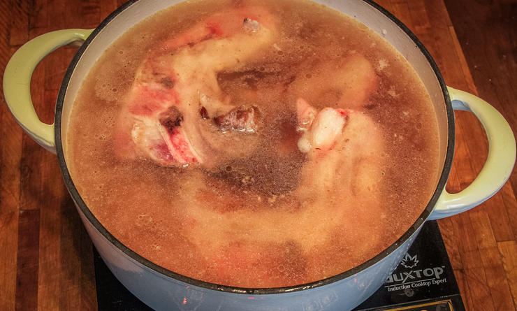 After browning the meat, cover it with water and simmer until tender.