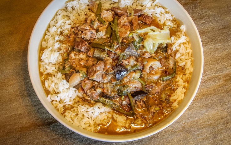 Serve the kare kare over rice and with spicy shrimp paste known as bagoong.