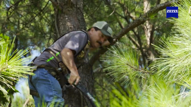 Joe Schults gives a Pine tree branch a good death ... all in the name of quality shooting lanes. (Realtree photo)