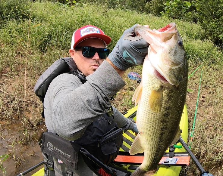 Realtree Fishing pro staffer Drew Gregory shows off a fat Lake Dardanelle bass, caught from his kayak.