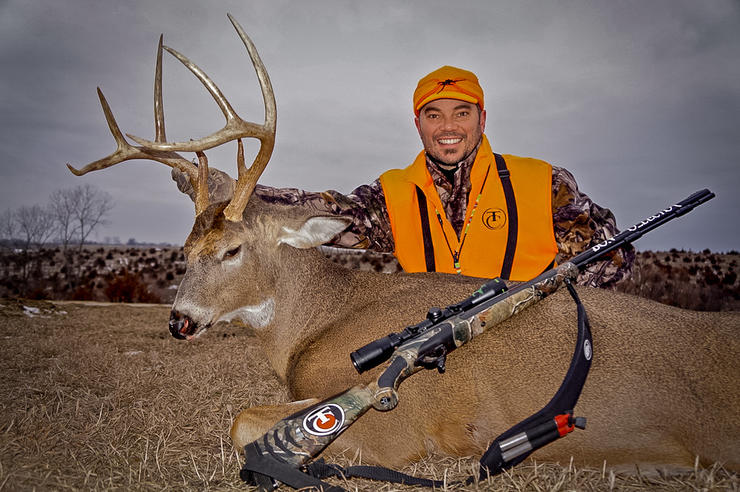 Bone Collector's Nick Mundt poses with a great late-season Iowa buck. (Bone Collector photo)