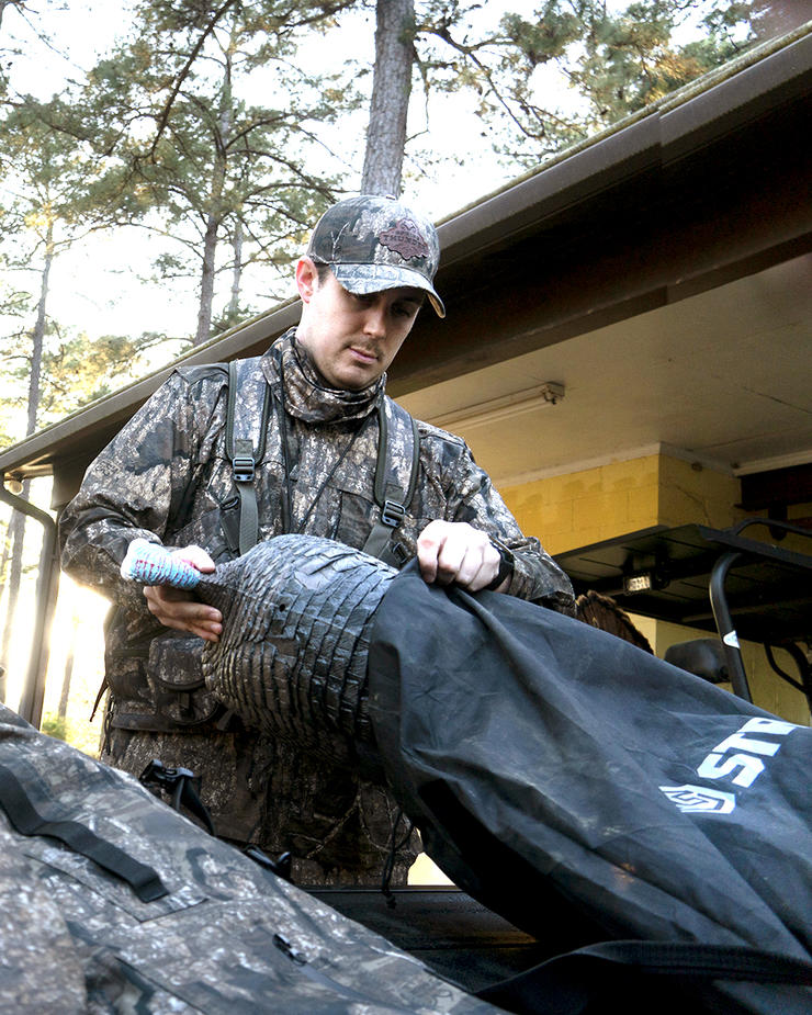 Realtree's Tyler Jordan loads a decoy into his four-wheeler before the hunt. Image by Realtree/Tyler Jordan