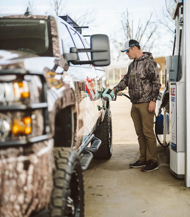 Realtree's Tyler Jordan gasses up during a recent road trip. Image by Hunter Phelps/Realtree Road Trips