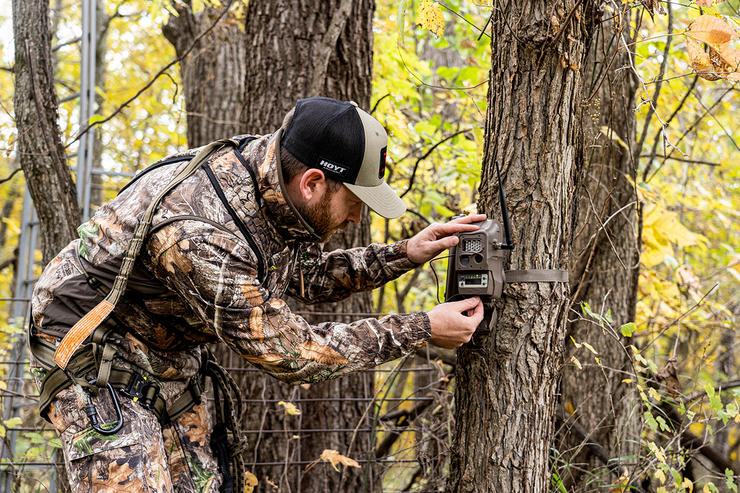 Hang cameras in locations that have multiple features that connect at a common point. It could be a scrape on a field edge, or it could be a trail intersection. Image by Realtree 365