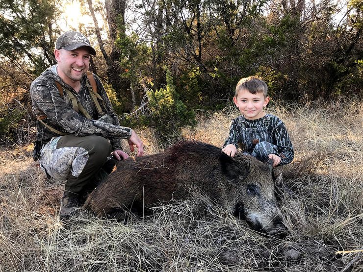 The author and his son with a Texas pig.