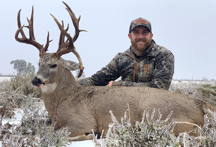Kyle Barefield was all smiles after recovering his huge Oklahoma whitetail. Image by All Things Hunting