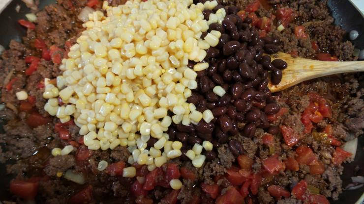 Add corn, black beans and Rotel to browned venison.