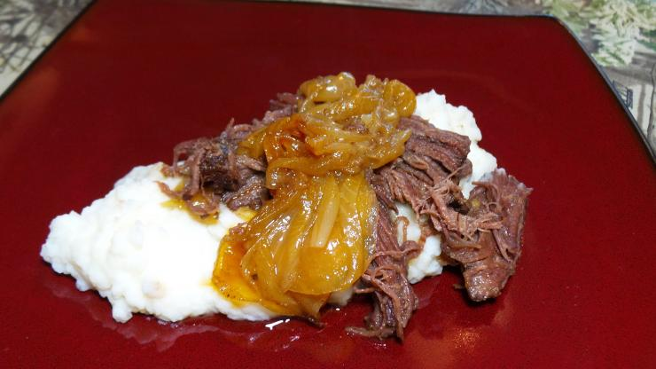 Beer braised elk chuck roast and onions served over mashed potatoes.