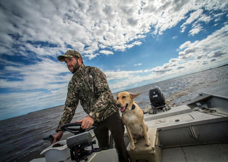 Blinds and pits are great, but the open water calls to many hunters. Plying big-water divers where they feed and loaf is a unique waterfowling experience. Photo © Bill Konway