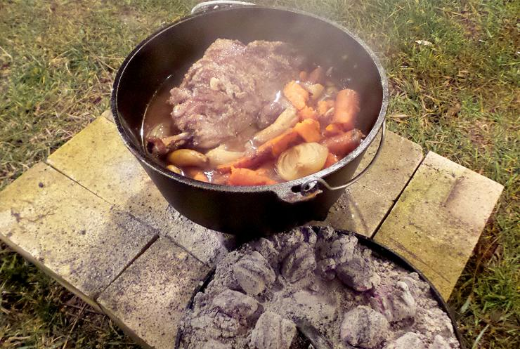 Use charcoal briquettes below and on top of the Dutch oven for a long and slow heat source.