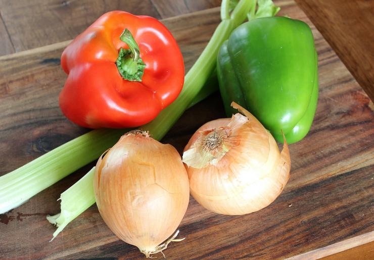 All good gumbo starts with the Cajun holy trinity of bell peppers, onions, and celery.