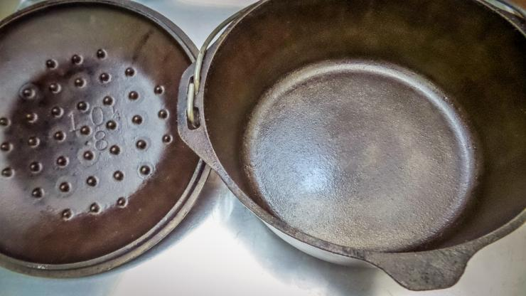 Even after cleaning and restoration, the seasoning layer on a cast iron pan will continue to darken with age.